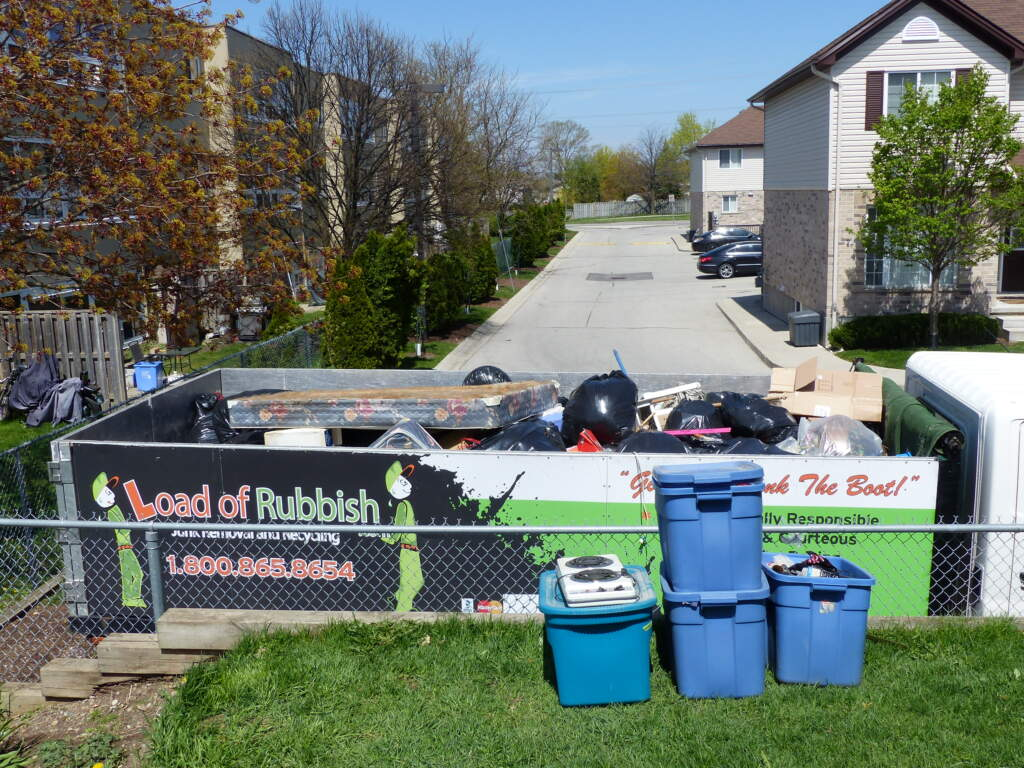 A lifetime's worth of possessions relegated to a junk removal truck and bound for recycling